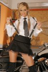 eva in a black miniskirt strips naked by a two tone road king 001.jpg