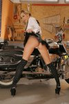 eva in a black miniskirt strips naked by a two tone road king 002.jpg